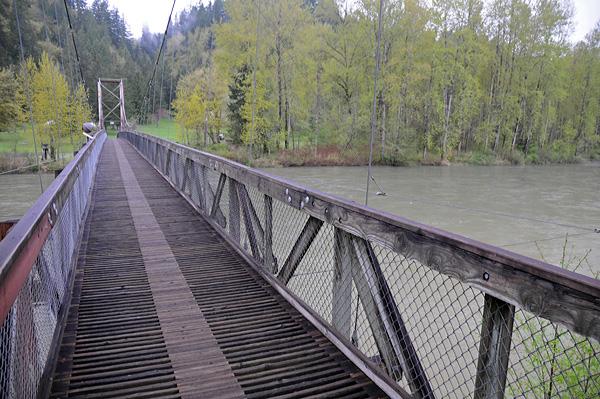 Tolt MacDonald Park suspension bridge walking over Snoqualmie River in Carnation