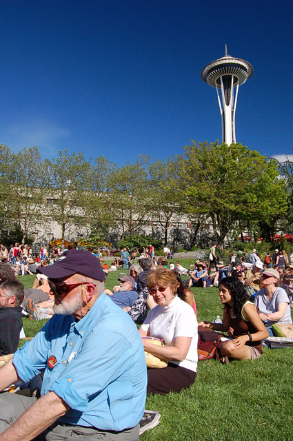 Seattle Northwest Folklife Festival Watching Fiddler Performance At Seattle Center Fisher With Space Needle In Background