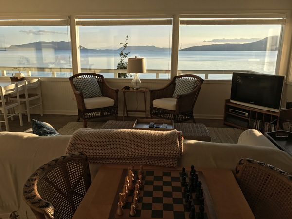 Cottage By The Sea living room on Lummi Island sunset view over Orcas Island