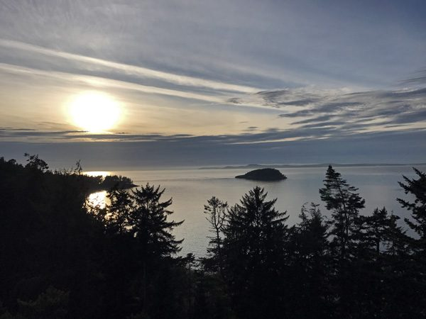 Adventure Terra sunset tree canopy climb Deception Pass State Park view west to Strait of Juan de Fuca from top