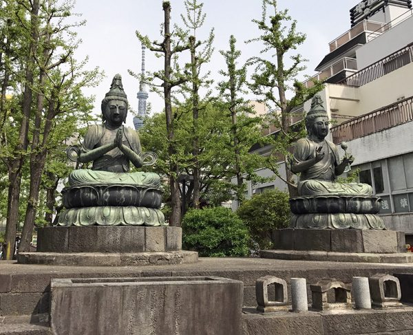 Buddhist statues in Asakusa Tokyo Japan with Tokyo Skytree behind