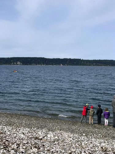 Kayaking to shore at Cama Beach State Park on Camano Island