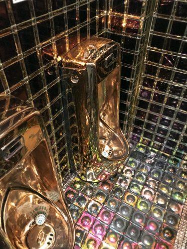 Robot Restaurant golden urinals in mens bathroom Shinjuku Tokyo Japan