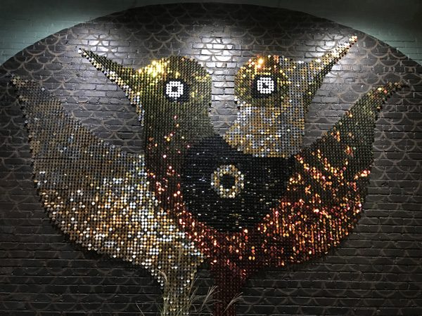 Dove Nest sequins mural moves with wind in Overton Square Midtown Memphis