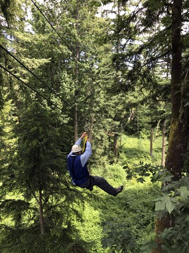 Canopy Tours Northwest zip line tour on Camano Island rider through trees