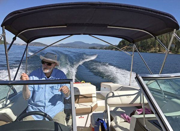 Driving speed boat on Lake Coeur d'Alene Idaho