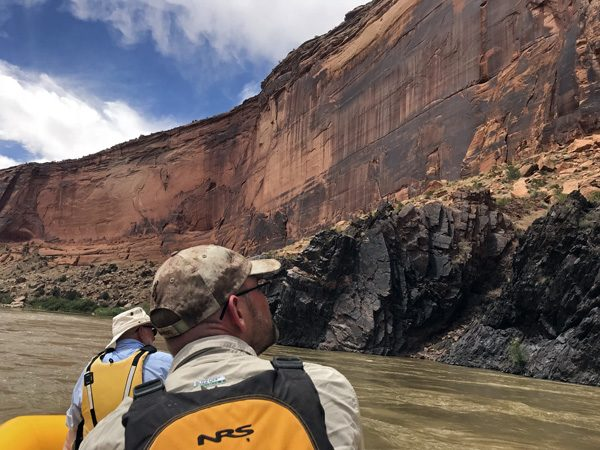 Rafting by Westwater Canyon walls on Colorado River