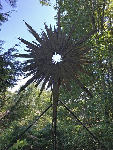 Wood sunburst sculpture at Websters Woods art park in Port Angeles