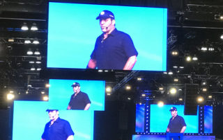 Tony Robbins on big screens at Unleash the Power Within at Los Angeles Convention Center