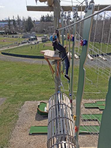 High Trek Adventures rope course zip line Everett climbing across swinging rock walls