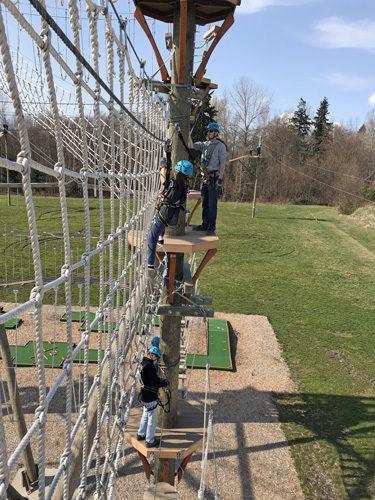 High Trek Adventures rope course zip line Everett climbing across vertical rope net