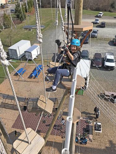 High Trek Adventures rope course zip line Everett making way across element