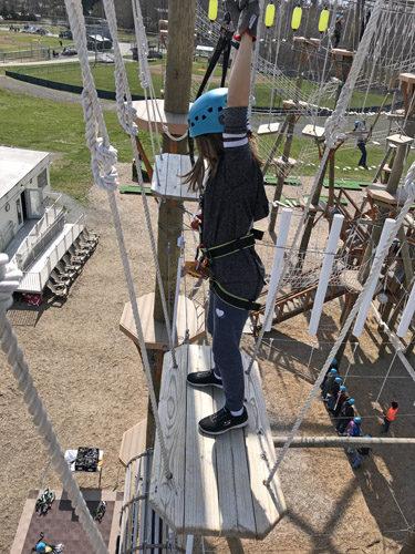 High Trek Adventures rope course zip line Everett on swinging platform
