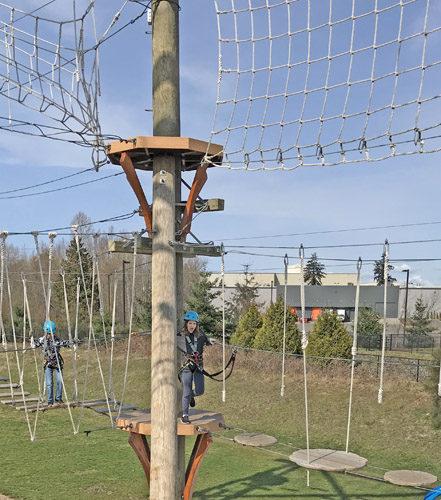 High Trek Adventures rope course zip line Everett platform between elements