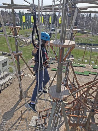 High Trek Adventures rope course zip line Everett straddling rope loops