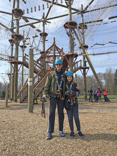 High Trek Adventures rope course zip line Everett wearing gear