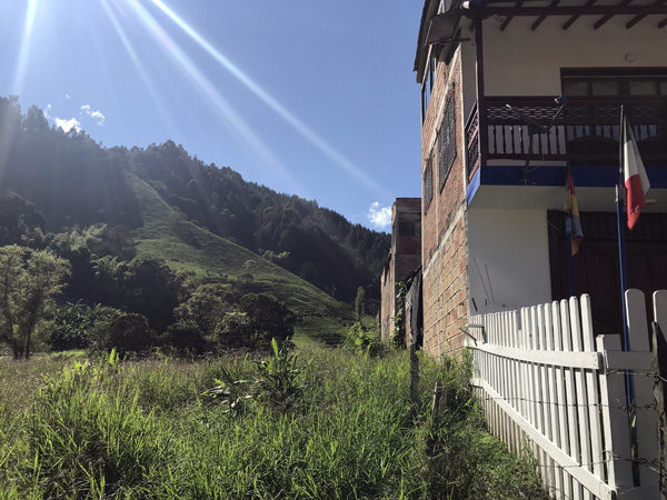 Building and hills on outskirts of northwest Jardin Colombia