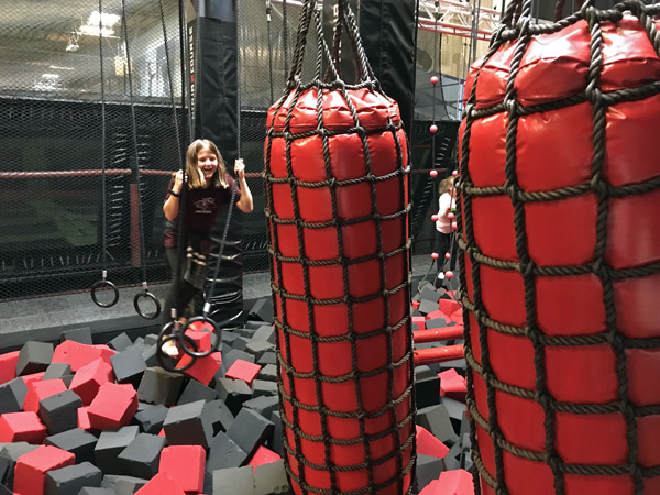 Elevated Sportz Trampoline Park Event Center on rings of Ninja Course