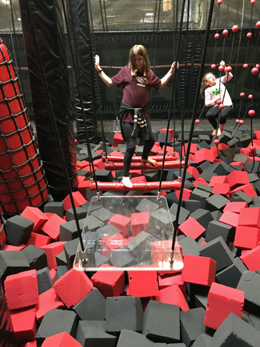 Elevated Sportz Trampoline Park Event Center on swinging bars of Ninja Course