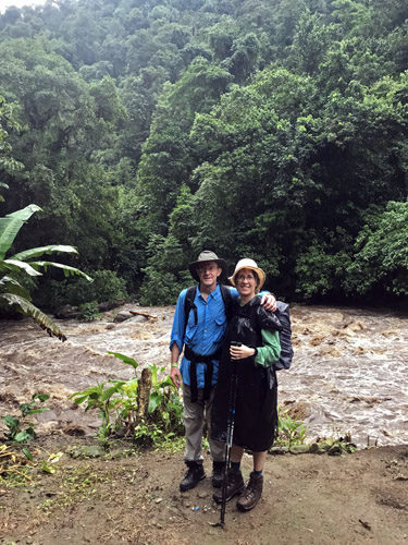 Hikers soaked from rain by raging river on trail to The Lost City Ciudada Perdida