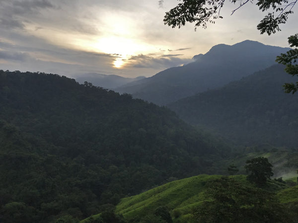 Sunrise over Sierra Nevada mountains jungle in Colombia on trail to The Lost City Ciuidad Perdida