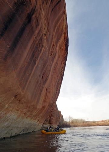 San Juan River Utah under canyon wall