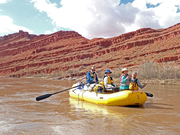San Juan River Utah group rafting by rock formations