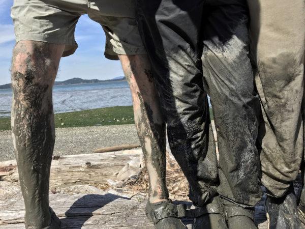 Mud covered legs after hauling kayak across sinking mud tide flats at Borgman Road end water access