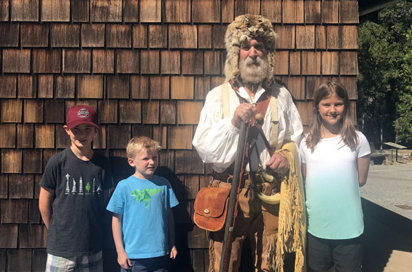 Kids with historical actor at Empire Mines State Park annual Miners Picnic