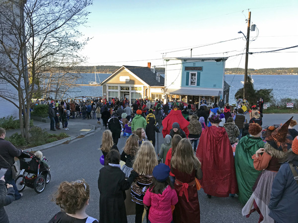 2019-10-26 Friends walking with crowd in Coupeville Halloween Torchlight Parade