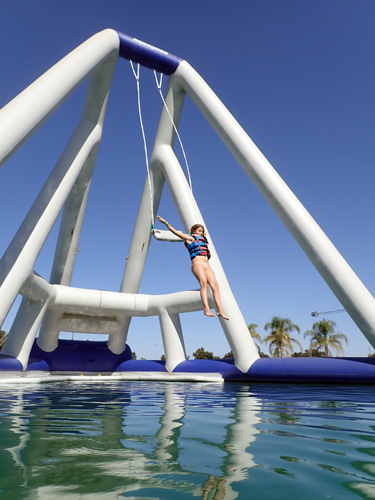 Leaping from high swing at Velocity Island Aqua Park in Woodland California