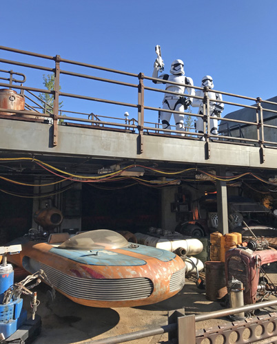 Walt Disney World Star Wars Galaxy's Edge storm troopers and land speeder in Hollywood Studios