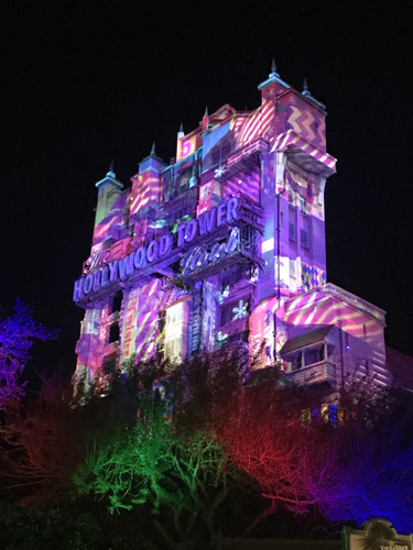 Walt Disney World Twilight Zone Tower of Terror lit up at night in Hollywood Studios