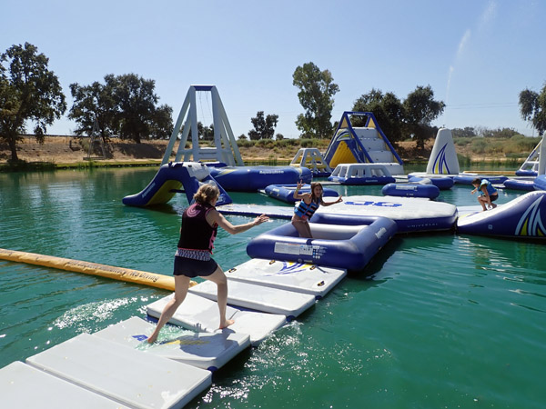 Running across water platforms at Velocity Island Aqua Park in Woodland California