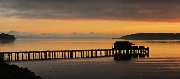 Penn Cove pier at sunrise in Coupeville on Whidbey Island