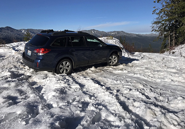 Subaru Outback in snow on Forest Road 2810 to North Mountain Fire Outlook near Darrington